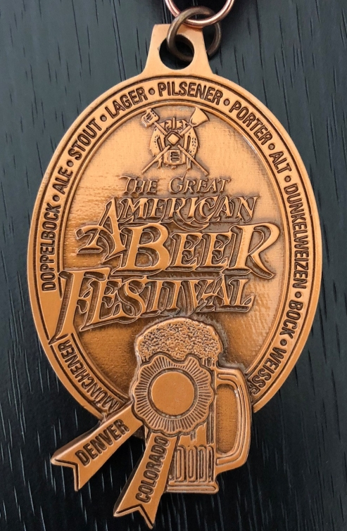 A close up of Stereo's bronze medal, awarded for Wall of Sound (Oatmeal Stout)